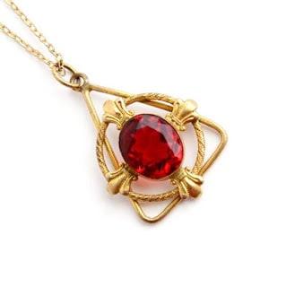 Attractive-Triangular-Single-Ruby-Stud-Gold-Pendant