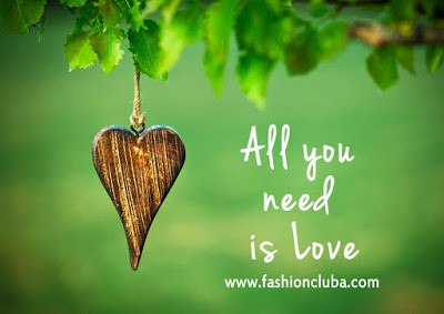 All-you-need-is-love-inspirational-quote-on-natural-green-background-with-wooden-shape-of-heart.