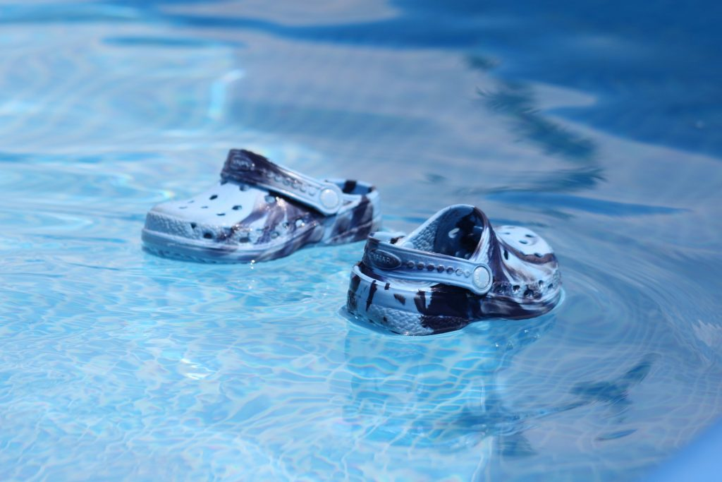 Sandals floating on water